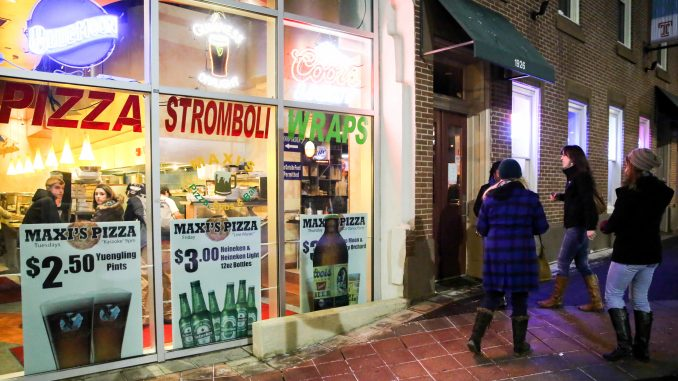 Maxi's, a popular campus bar and eatery, was busted for serving nine underaged patrons, four of whom were caught using fake IDs. The LBC has yet to file a violation against the establishment. | Hua Zong TTN