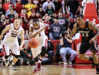 Freshman Josh Brown (middle) and senior Dalton Pepper sprint toward a loose ball during the team's most recent home loss to Cincinnati.   HUA ZONG TTN