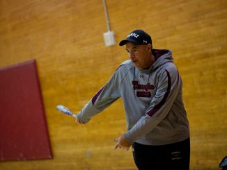 Softball coach Joe DiPietro helps his team prepare for the final season the program will compete in before it is slated to be cut in July. | Alex Udowenko TTN