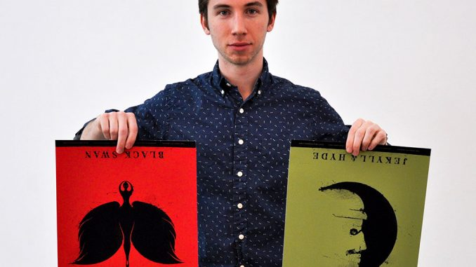 """Max Amato holds two prints of his own design, themed after """"Black Swan"""" and """"Jekyll & Hyde."""" 