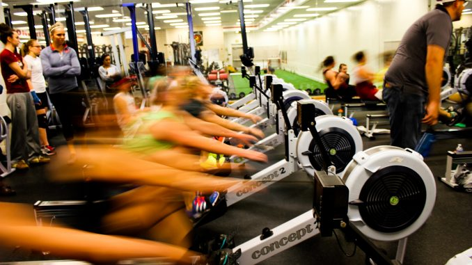 Members of the women's rowing team pull back on ergometers, indoor rowing machines that imitate the actions of rowing. The test was the fourth and final one for the squad this season. | Edward Barrenechea TTN