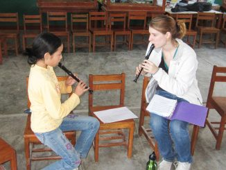 """Elizabeth Moulthrop practices the recorder with a student in Pisco, Peru in 2012 as a part of her """"Notes for Change"""" program, where she aims to spread musical education throughout the country. 