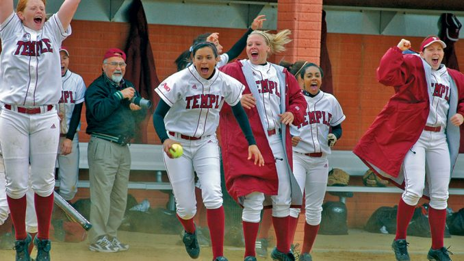 Members of the 2006 softball team celebrate during a spring game at the Ambler Sports Complex. The Board of Trustees voted to cut the team in December. | TTN FILE PHOTO