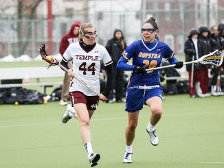 Nicole Tiernan runs past a Hofstra defender during the Owls' 9-8 overtime win. The Owls were down 7-1 before coming back in the second half. | HUA ZONG TTN