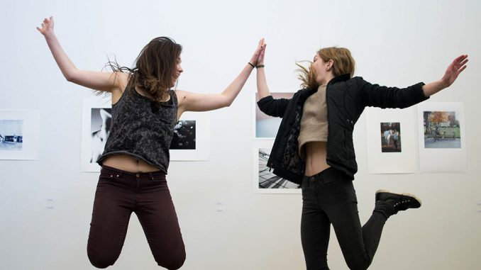 """Rosie Wiegand (left) and Lindsay Thompson curated the """"Call + Response"""" exhibit, which features both Tyler and University of the Arts students' work. 
