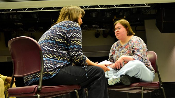 Erin McNulty (right) interacts with another cast member in a play produced by Visionary Voices. | Sergei Blair TTN