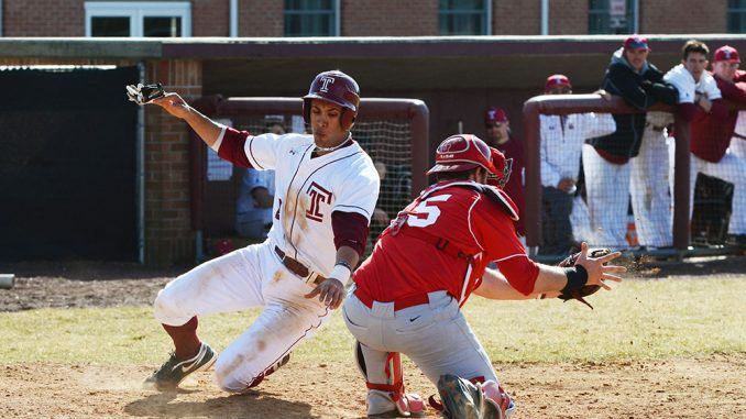 Robert Amaro (left) slides into home plate during Temple's comeback victory against Saint Peter's College. Amaro is batting .292 and leading the Owls with 13 RBIs after a three-year career at the University of Virginia. | Andrew Thayer TTN