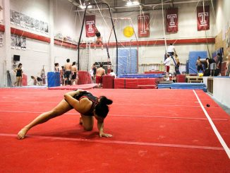 Jasmine Johnson finishes a routine on the mat in McGonigle Hall during a recent practice. | Kelsey Dubinsky TTN