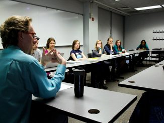 Andrew Karpinski (left) has taught Workings of the Mind for six years. He believes the subject matter of the class can cause some students to feel discomforted because they are asked to question the purpose of their own existence. He advises the use of on-campus counseling services. | Claire Sasko TTN