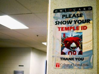 A sign posted in Anderson Hall warns students to have their Temple IDs ready to present to security guards at the building's entrance. The board approved funding for more security measures in Anderson and Gladfelter halls. | Jillian Hammer TTN FILE PHOTO