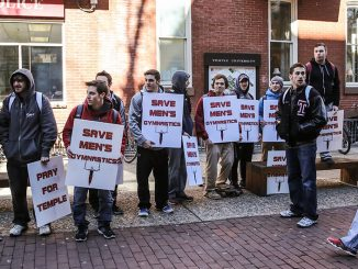 Members of the men's gymnastics team protest near Liacouras Walk before February's Board of Trustees meeting that led to the reinstatement of the crew and rowing teams. The program is slated to be eliminated on July 1. | HUA ZONG TTN