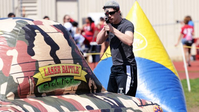 A student plays laser tag at the university-sponsored Cherry On Experience, an alternative to the canceled Spring Fling, held at the Geasey Field Complex last weekend. | Andrew Thayer TTN