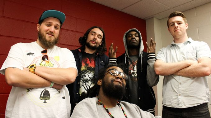 (From right) Rappers P64, Buggie Fresh, Prophet Lethal Dose and OHM (front) collaborate with the help of DJ Cody Griz (far left) to form the Hungry Ghosts.| Claire Sasko TTN