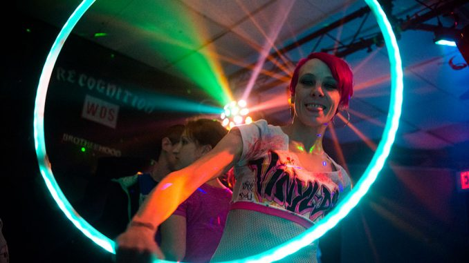 A dancer from Vinyl Doll Productions, a dance performance crew, performs with a hula-hoop at an event in the city's Allegheny neighborhood on March 29. | Abi reimold TTN