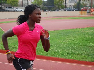 Sophomore Jamila Janneh runs around the track on Main Campus during a Fall 2012 practice. Janneh is the new school record holder in the outdoor triple jump.   Andrew Thayer TTN