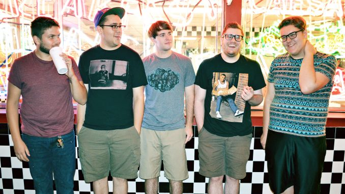 Members of the five-piece band, Uncle/Father Oscar, are entering the emo-punk band scene in Philadelphia with a new split with A Day Without Love. Jared Whalen | TTN
