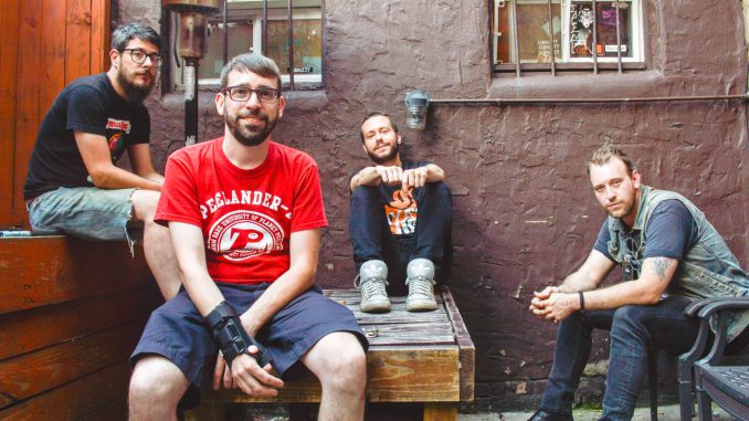 Band members Tim Hoh Jr., Jim, Dim and Tony Goggles started making one music video a month for a year. BRIANNA SPAUSE | TTN