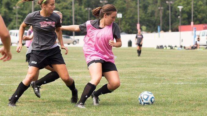 Forward/Midfielder Morgan Evans (right) controls the ball during a drill in practice. Andrew Thayer | TTN