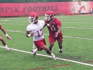 Newly-annointed receiver Brandon Shippen attempts to shake defensive back Sean Chandler in a pass route. Shippen was one of five Temple players to change positions before the season. | Nick Tricome TTN