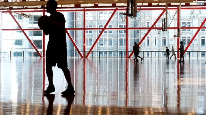 Students play basketball in the Fitness Mezzanine of Pearson and McGonigle Halls. Students can receive activity rewards through two fitness programs. Allan Barnes   TTN