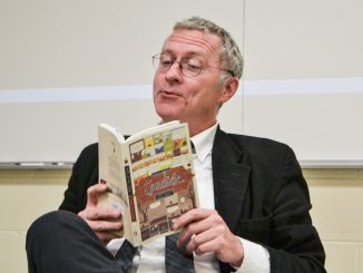 """Mosiac Adjunct Professor Dan Touey reads from Voltaire's """"Candide"""" during a Mosiac class on Sept. 29. Andrew Thayer 