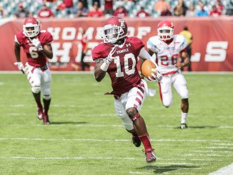 Sophomore Khalif Herbin returns a punt for a touchdown during Temple's 59-0 blowout against Delaware State on Saturday. Hua Zong | TTN