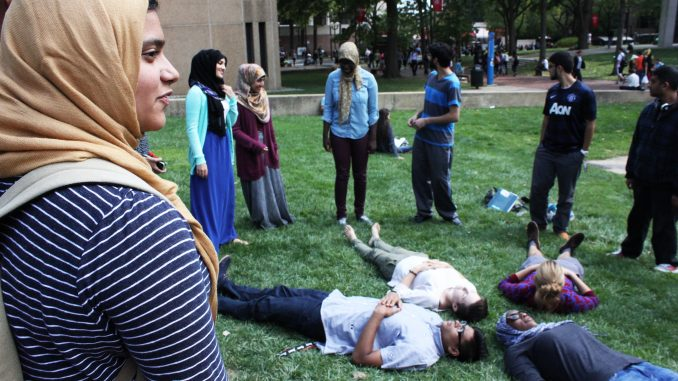 Members of the Muslim Student Association came together to form a human peace sign on Sept. 18. Claire Sasko | TTN