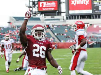 Jaime Gilmore celebrates his four-yard rushing touchdown in the first quarter of Temple's 59-0 blowout win against Delaware State Saturday. | Hua Zong TTN