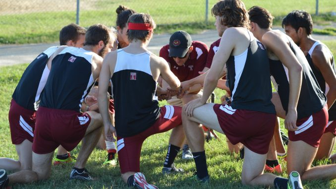 Coach James Snyder shares some final words to the men's team before its race at Belmont Plateau Saturday in the Friend Big 5 Invitational. | Greg Frangipani TTN
