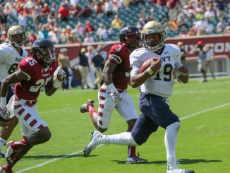 Navy quarterback Keenan Reynolds rushed for 173 yards, 22 yards more than the entire Owls offense on Saturday afternoon at Lincoln Financial Field. Hua Zong | TTN