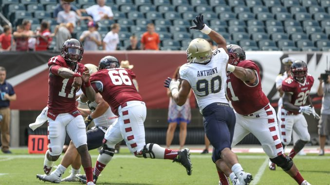 P.J. Walker throws a pass in Temple's 31-24 loss to Navy. Walker completed 29 of 49 passes for 240 yards with two touchdown passes and one interception. | Hua Zong TTN