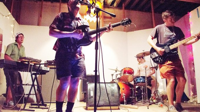 """With Dan Rohe on keys, Robin Carine on guitar, Matt Kay on bass and Adam Ferguson on drums, Post Sun Times practiced in its South Philadelphia studio on Thursdays to work on its recently released EP, """"PST."""" Brianna Spause 