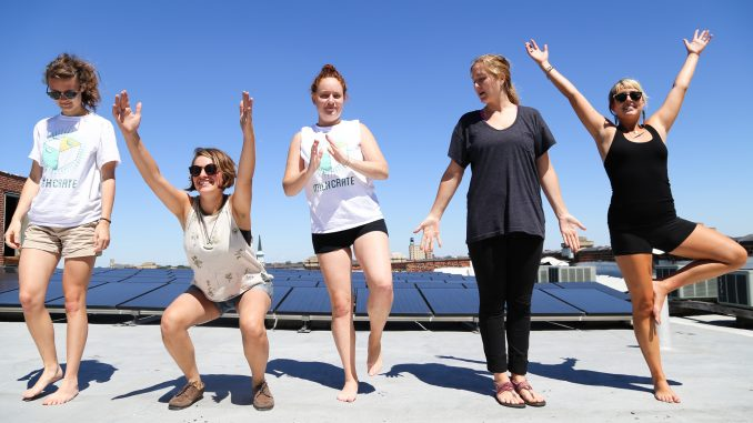 Members of MilkCrate and Solar States practice their yoga moves on the rooftop of the Crane Arts Building in Olde Kensington. Left: Nicole Koedyker, Maddie Allen- Sandoz, Caitlin Honan, Mary Jo Burnham and Ashley Tryba. Andrew Thayer| TTN