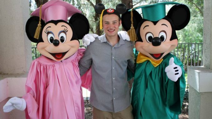 Cameron Resnick, a Temple student, stands with Mickey and Minnie Mouse after graduating from the Disney College Program. | COURTESY CAMERON RESNICK