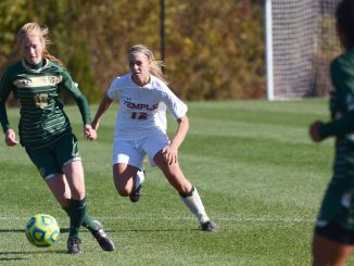 Sophomore midfielder Elaine Byerley pursues South Florida midfielder Kate Loye during last Sunday's game against the Bulls. The Owls lost 2-0, their fourth conference loss of the season. Jenny Kerrigan | TTN