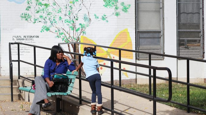 Alana Buckner (top) waits outside of the Tanner Duckrey Elementary School with her daughter. Alisa Miller | TTN