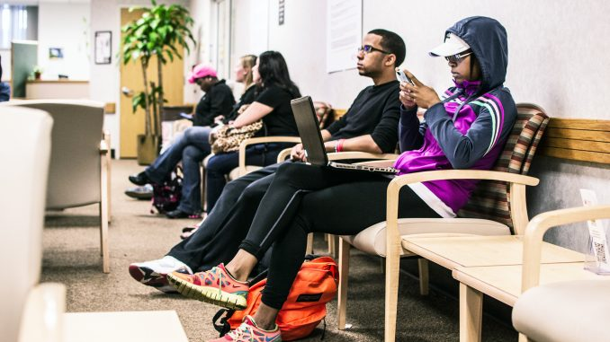 Students wait for their names to be called in the Student Financial Services office on Sept. 30. Aaron Windhorst | TTN