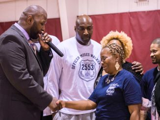 Wayne Lipscomb (right) became emotional during a local tournament held in honor of her late son, who was an officer with the Philadelphia Police. Brianna Spause   TTN