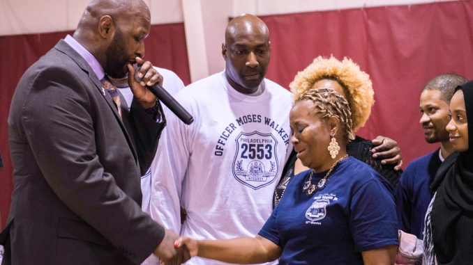 Wayne Lipscomb (right) became emotional during a local tournament held in honor of her late son, who was an officer with the Philadelphia Police. Brianna Spause | TTN