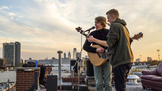 Eric Doguet and Robbie Fischer of Eric & Robbie perform at The Block Jam, a rooftop concert at the corner of Diamond and Carlisle streets, held on Nov. 9. Kara Milstein   TTN