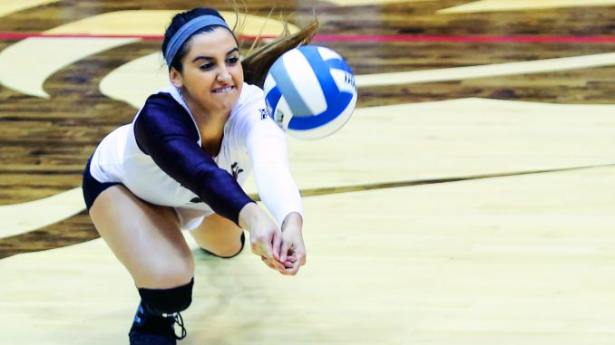 Senior middle blocker Jennifer Iacobini digs the ball during the Owls' 3-0 win against South Florida last Friday. Iacobini has started in 19 of the Owls' 26 games during her last season. Hua Zong | TTN