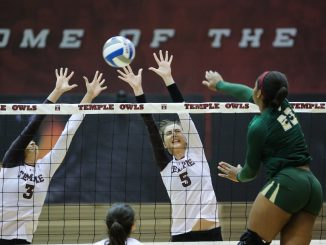 Jennifer Iacobini (left) and Dara Peric (right) successfully close a block against South Florida's Priscilla Ehieze in Temple's 3-0 win against the Bulls. | Hua Zong TTN