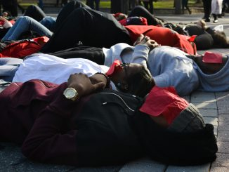 """Students lay on Liacouras Walk as part of a """"die-in"""" staged Thursday afternoon. 