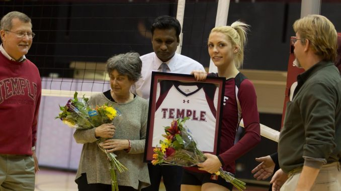 Tiffany Connatser receives flowers and a framed jersey alongside her parents last Friday. Donald Otto | TTN