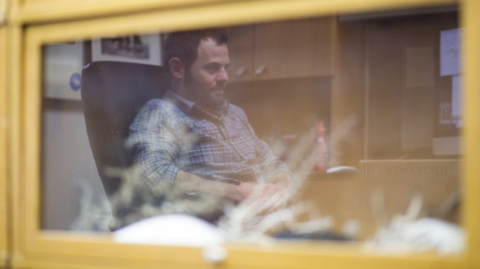 Dr. Erik Cordes is reflected in a case of coral in his office in the Bio-Life building. Cordes and a team of researchers collected coral samples for the tests during a month-long trip on a research ship in 2010. |KARA MILSTEIN TTN
