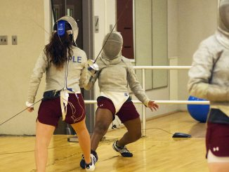 Junior sabre Gloria Aguilar practices against teammate Victoria Super last Thursday. | Margo Reed TTN