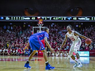 Senior guard Quenton DeCosey sizes up a Southern Methodist defender. | Chip Frenette TTN