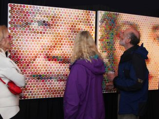 "Patrons admire ""Mandella and Liz"" by Gavin Rain at the E-Moderne Gallerie.   COURTESY E-MODERNE GALLERIE"