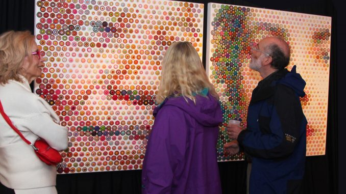 "Patrons admire ""Mandella and Liz"" by Gavin Rain at the E-Moderne Gallerie. 