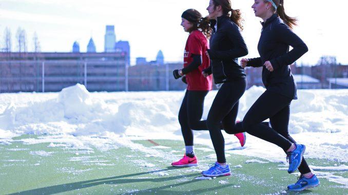 Runners Megan Schneider, (left), Andrea Mathis and Danielle Britton jog at Geasey Field last month.   Jenny Kerrigan TTN